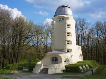 View of the modern white building of the Einstein Tower, a solar observatory belonging to the AIP in Potsdam.
