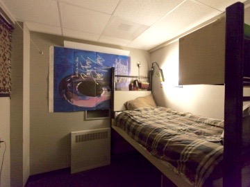 Private room in the station, with a bed, ligths, and posters on the wall. (Credit:Freija Descamps/NSF, 2011)