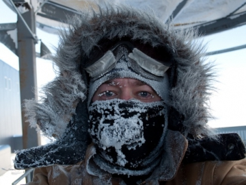 Portrait of E. Jacobi, clad in a winter anorak, goggles and facemask. (Credit: E . Jacobi)